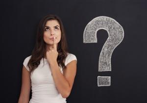 question woman with blackboard